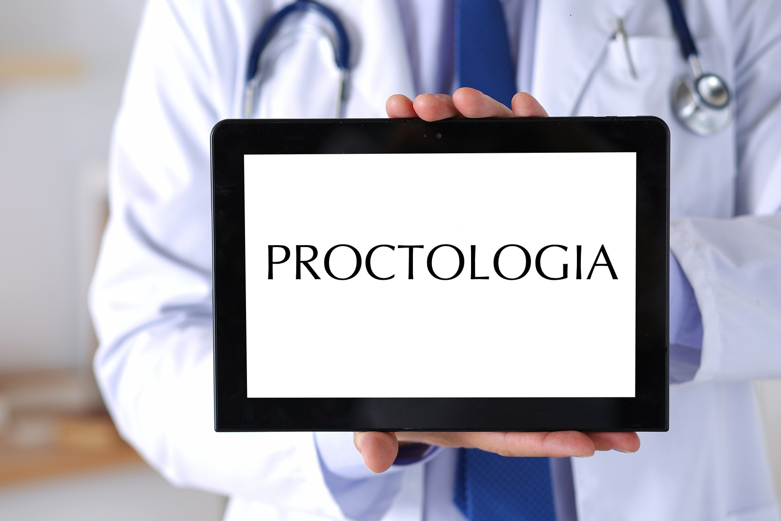 Male medicine doctor holding digital tablet pc and showing screen to camera. Medical equipment modern technology and communication concept. Therapeutist using portable computer searching information